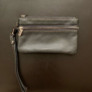 Genuine leather wristlet wallet.